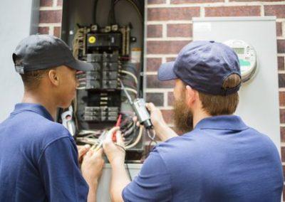 repairmen--electricians-repairing-home-breaker-box--528973846-5c853bc246e0fb00017b30f7